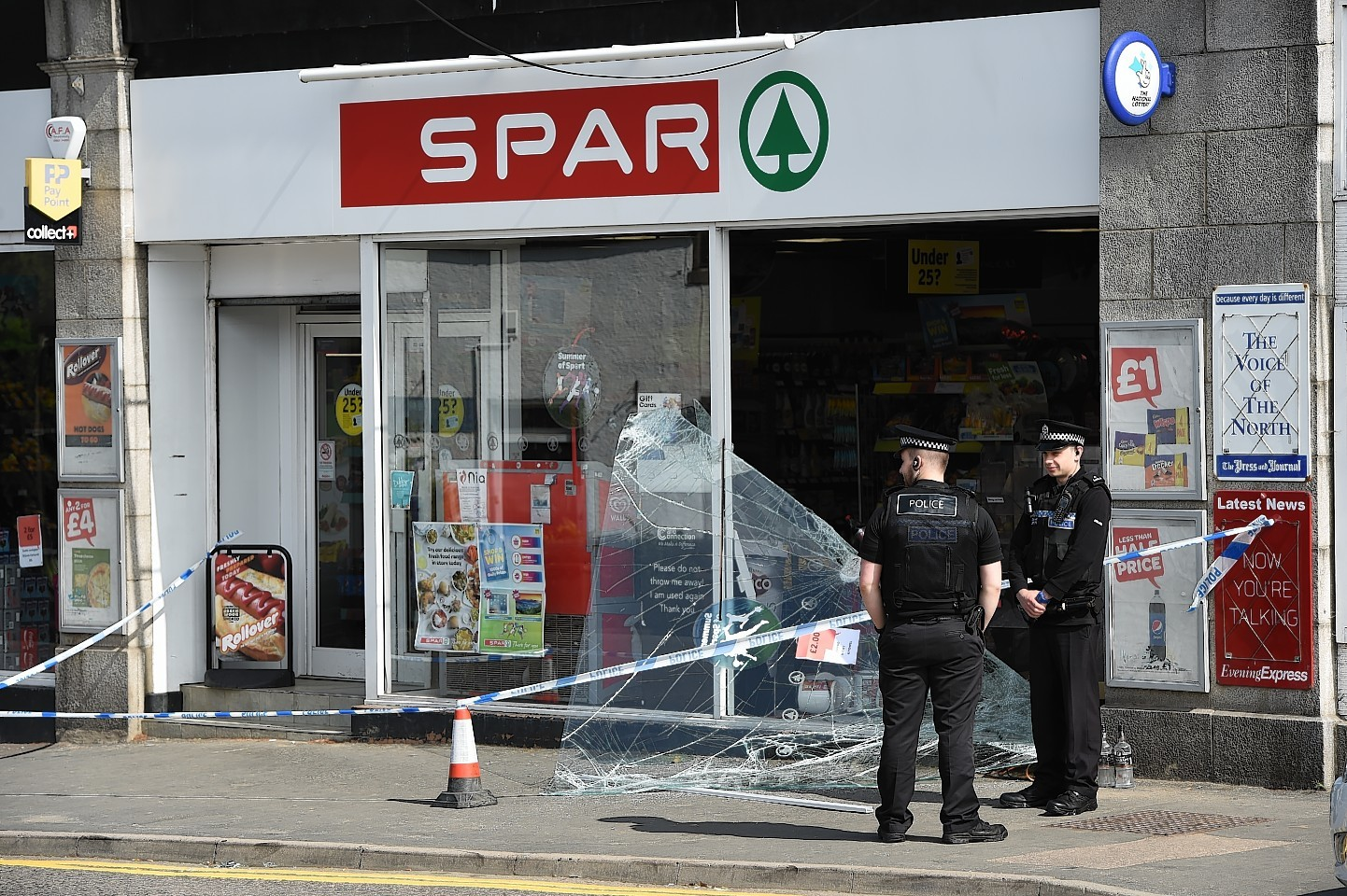 Police investigate the scene of the break-in. Pictures by Kenny Elrick