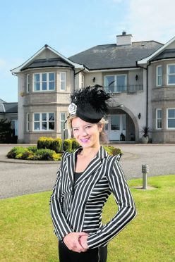 Mimi Theobald, a noted hat designer, who is selling her property Woodside House in Westhill, Inverness.