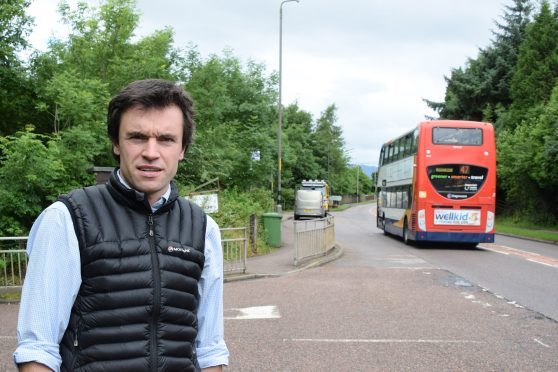 Councillor Ben Thompson at the road junction for Banavie Primary School