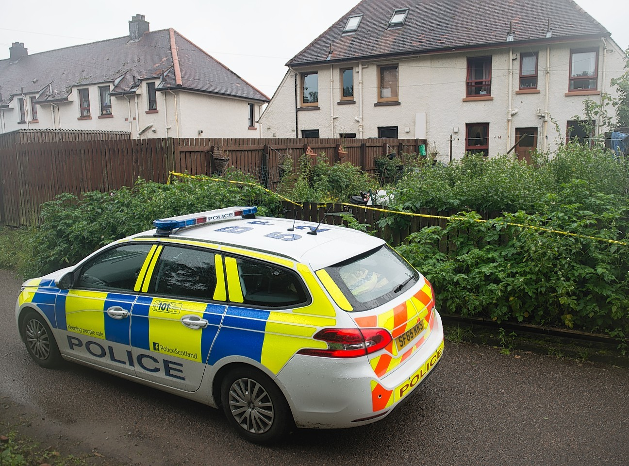 Police at the scene of the alleged chainsaw incident