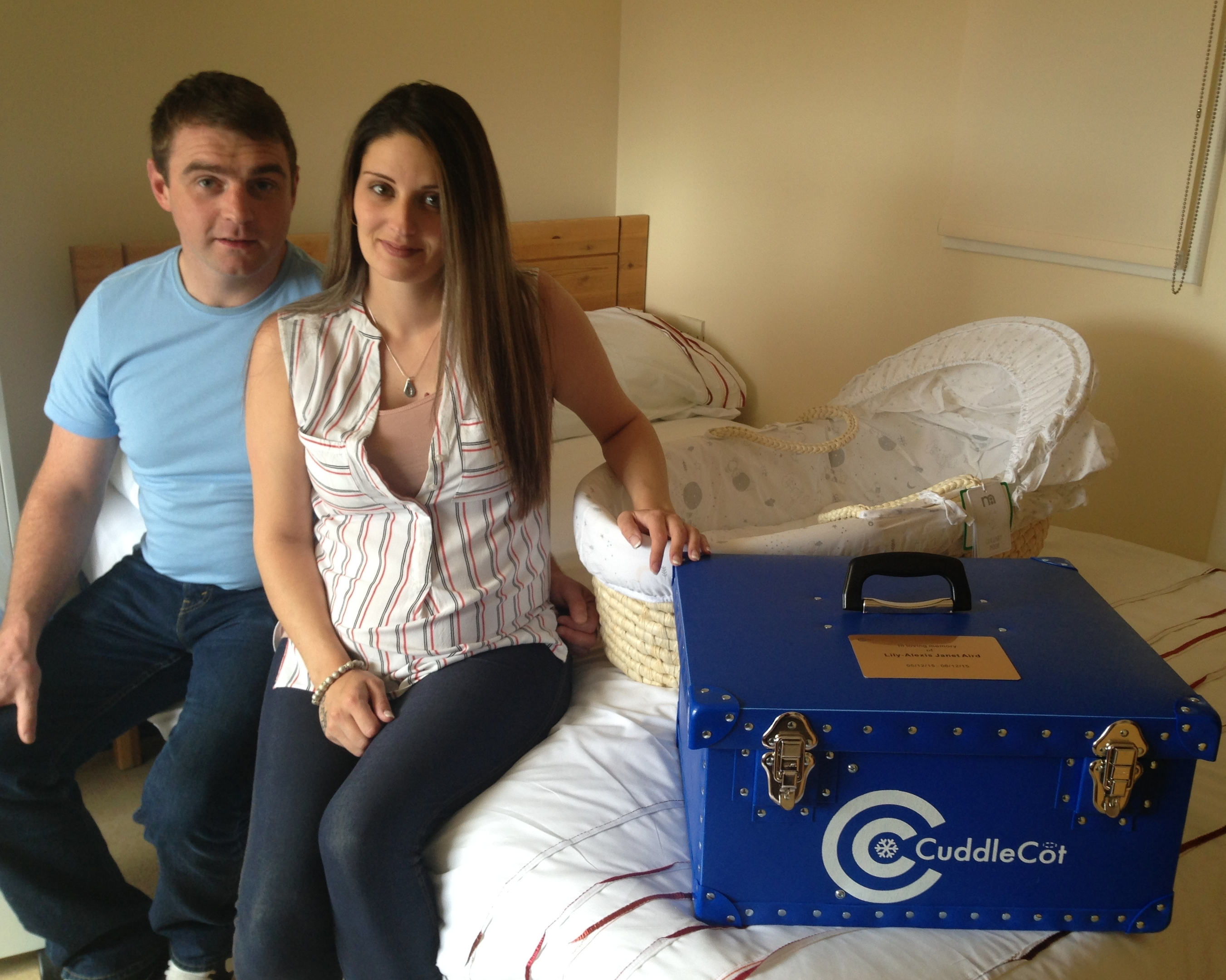 David and Emma with the cuddle cot and moses basket