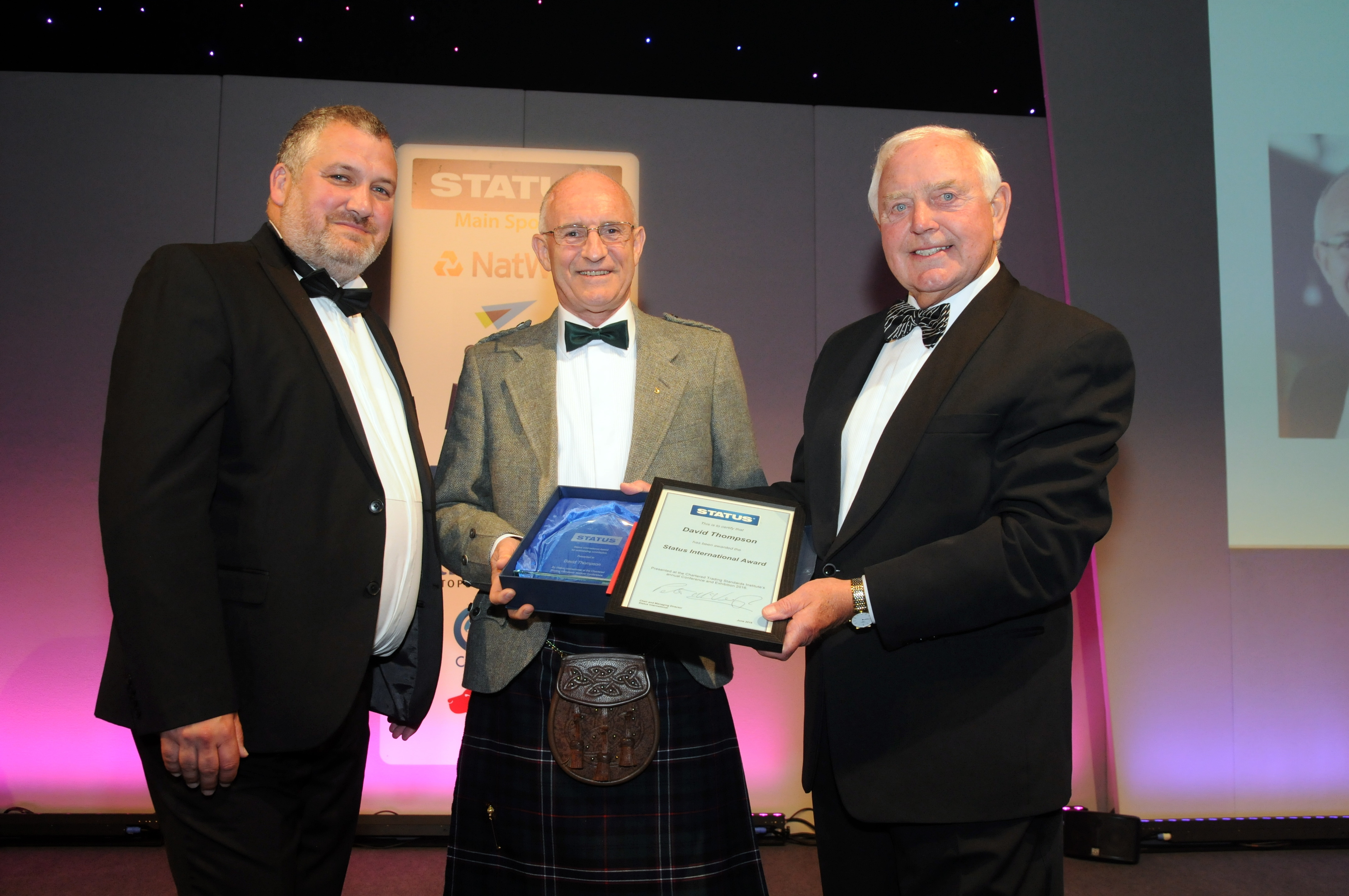 Dave Thompson is presented with a Status International Award from the Chartered Trading Standards Institute