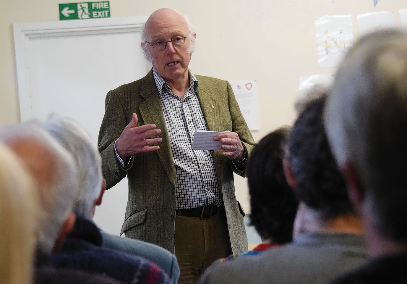 Trust chairman John Hutchison explains the proposed community buyout at the meeting in Inverlochy