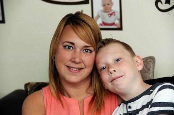 Nicola Nash with son Kai at their home in Elgin
