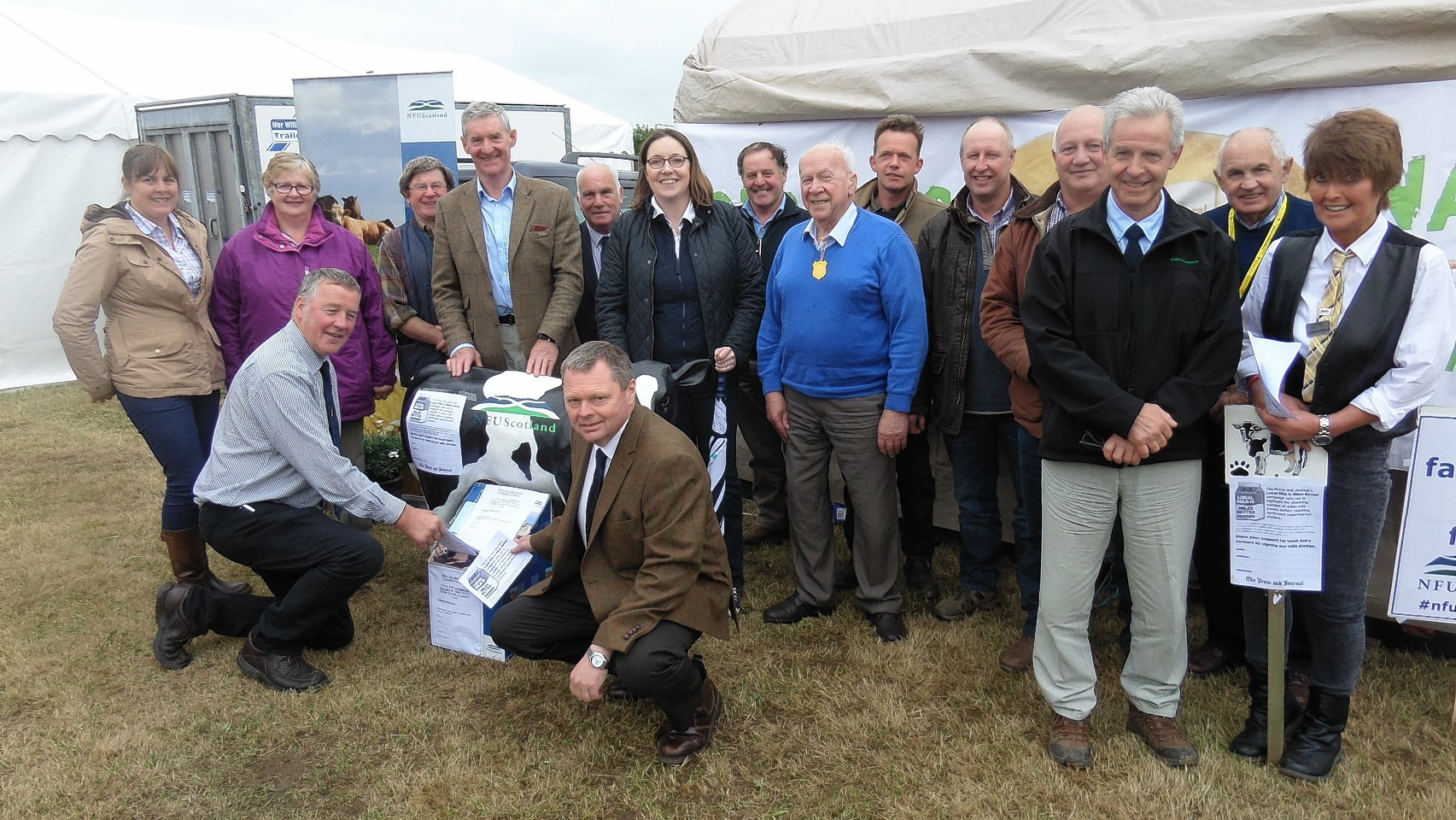 Farmers and politicians signing the petition at the New Deer Show