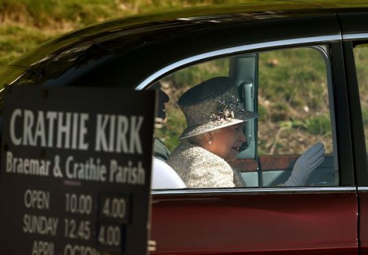 The Queen arriving at Crathie Kirk last year