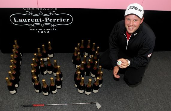 Andrew Johnston of England celebrates his hole in one