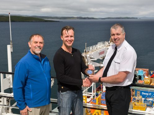 Capt Calum Grains (right) with Capt Marcin Trejtowicz  (centre) and John Seldon at the  Dales Voe Base.