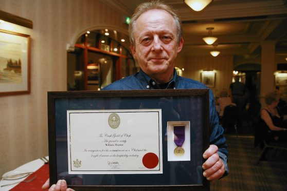 William Hunter with his Gold Medal and certificate