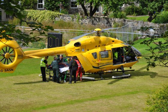 A victim is taken onto the air ambulance in Portsoy