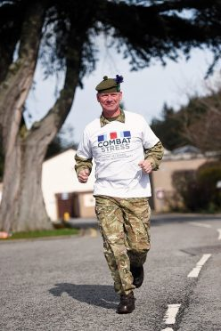 Doug Hamilton, at Baxters where he works, in training for the London Marathon to raise money for Combat Stress. (Picture: Gordon Lennox)