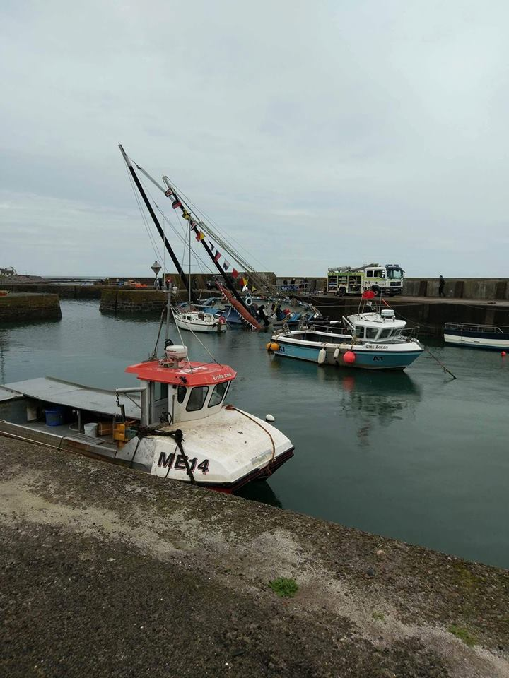 The submerged Reaper in Johnshaven Harbour