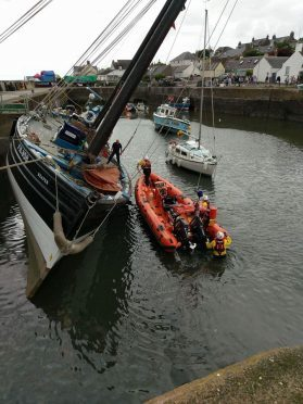 Coastguard with the Reaper in Johnshaven Harbour