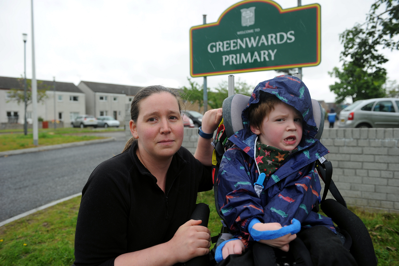 Gillian Groves and her son, Tom, outside Greenwards Primary School, Elgin, which he attends. Picture by Gordon Lennox.