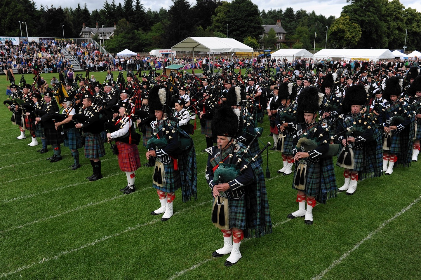 The massed bands gather for to pipe in the Lord Lieutenant. (Picture: Kenny Elrick).