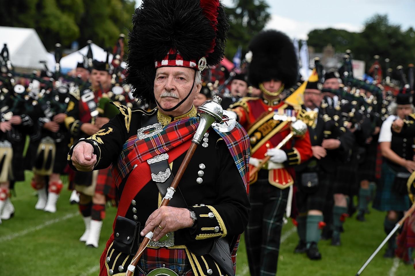 Massed pipe bands at Aboyne Highland Games. Credit: Kenny Elrick.