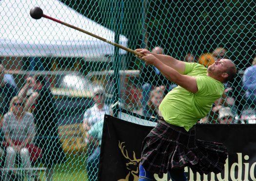 Rob Young at the hammer  at Aboyne Highland Games. Credit: Kenny Elrick.