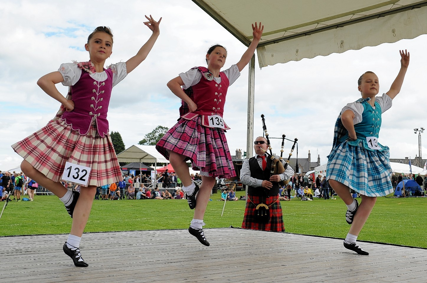 Picture of Highland dancers (L-R) Katie Douglas, 10, Robyn Gordon, 11, Olivia Cameron Richardson, 11, at Aboyne Highland Games. Credit: Kenny Elrick.