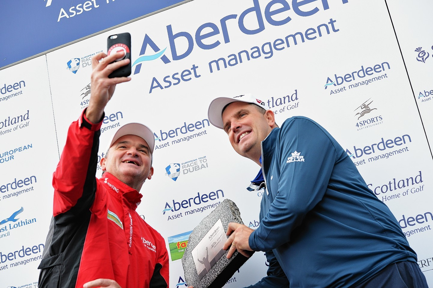 Tournament host Paul Lawrie and winner Anthony Wall.