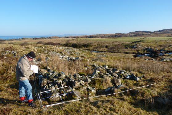 Members of AHHA creating digital imagery of the 18th century graveyard at Camas nan Geall