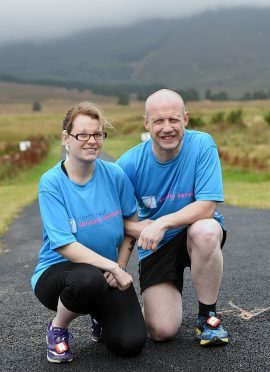 Leona Glennie who has partial sight and hearing loss and Neil Skene who is blind get ready to take part in the Banchory Beast Race at Knockburn Loch. Picture by KEVIN EMSLIE