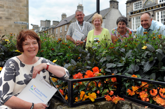Forres was judged by Scotland In Bloom judges, Liz Stewart, front and Joe Smyth, back left, showing them round Forres were, Dandra Maclellan, vice-chairwoman Forres In Bloom, back second left, Diane McGregor, chairwoman Forres In Bloom, back second right, and Grant Speed, Asistant Lands and Parks Officer Moray Council, back right. Picture by Gordon Lennox