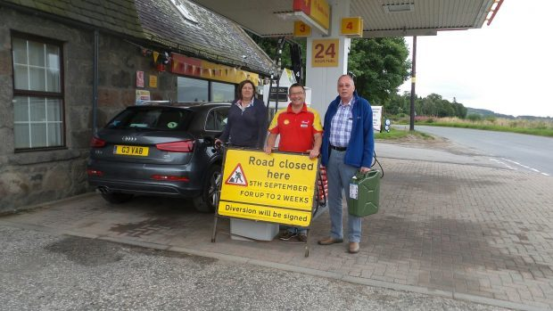 Geva Blackett, petrol station owner Peter Gray and John Lucas, chairman of the Torphins Community Council