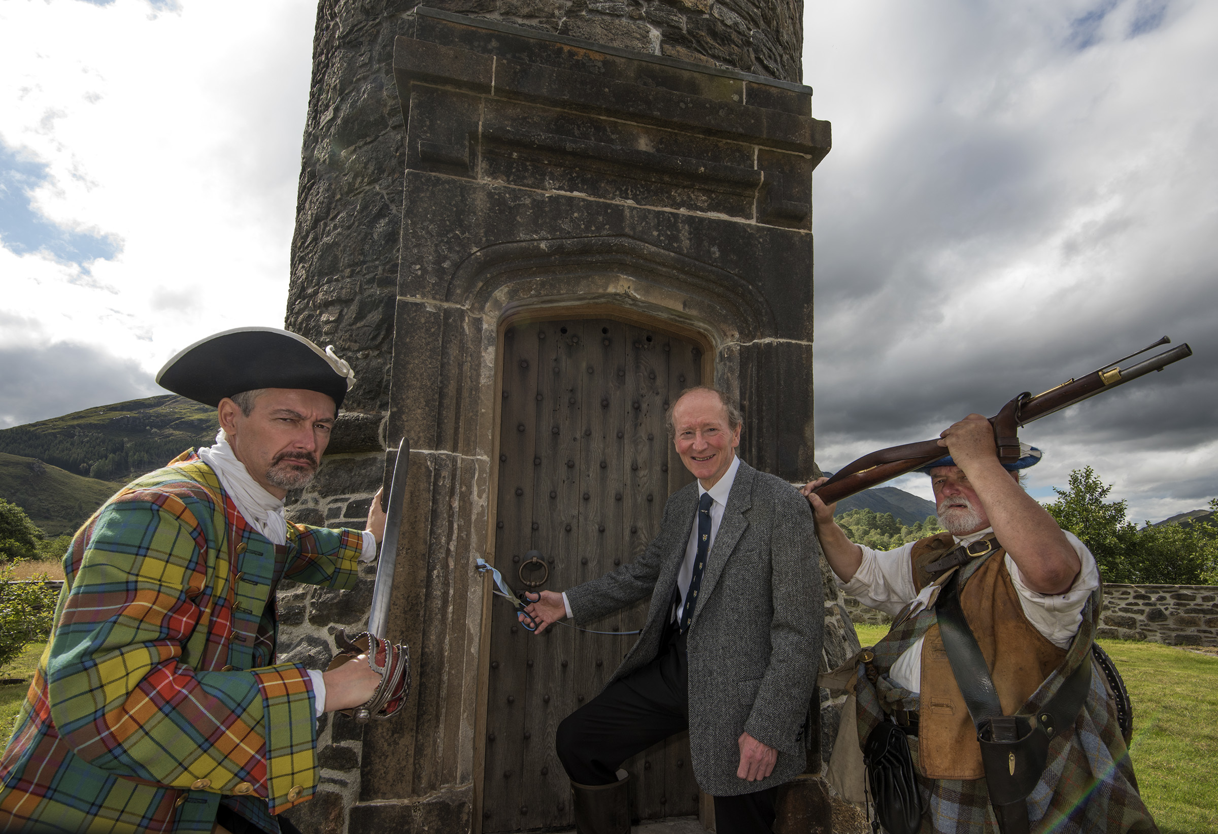 GLENFINNAN MONUMENT RE-OPENING.  20/08/16. Vice President of the National Trust for Scotland , Professor Hugh Cheap, (centre), officially re-opens Glenfinnan Monument after its restoration with the help of two 'Jacobites' (L-R, Jonathan Wartnaby, Learning Officer at Culloden Battlefield and Charlie Murray Beattie),     PIC THE WRITE IMAGE, FORT WILLIAM.  01397 703323.