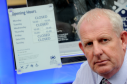 Leading Fochabers businessman, Gordon Christie, outside the Bank of Scotland in the Main Street, which is to close in November, leaving Fochabers without a bank. Picture by Gordon Lennox.