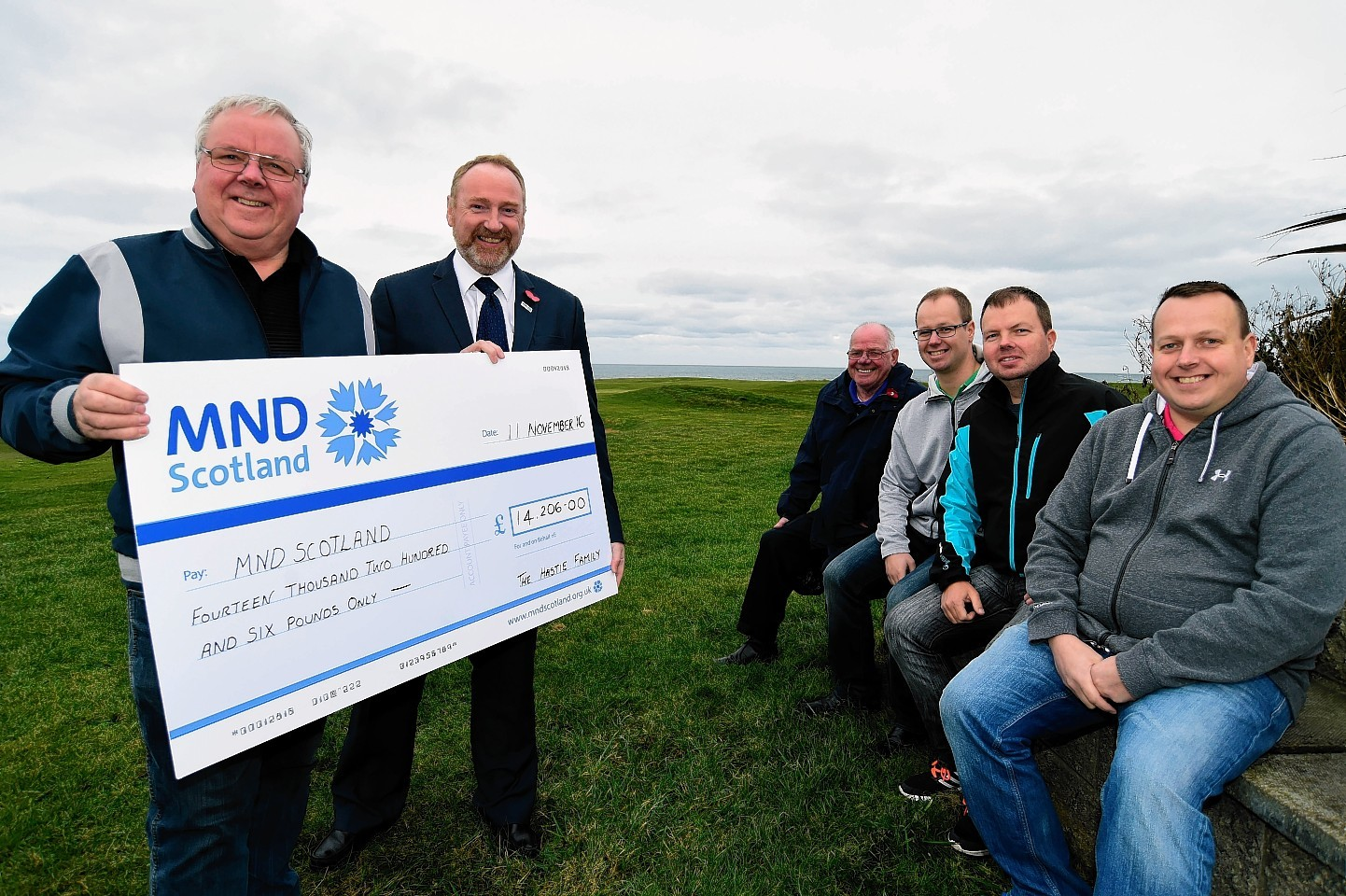 GEORGE HASTIE (L) AND MND SCOTLAND CEO CRAIG STILTON WITH A CHEQUE FOR £14,206, THE PROCEEDS OF A GOLF CHARITY DAY AT INVERALLOCHY ORGANISED BY THE HASTIE FAMILY.