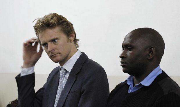Jack Marrian, left, appears at Kibera Law Court in Nairobi, Kenya
