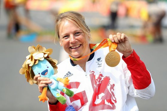 Karen Darke with her gold medal won in Rio