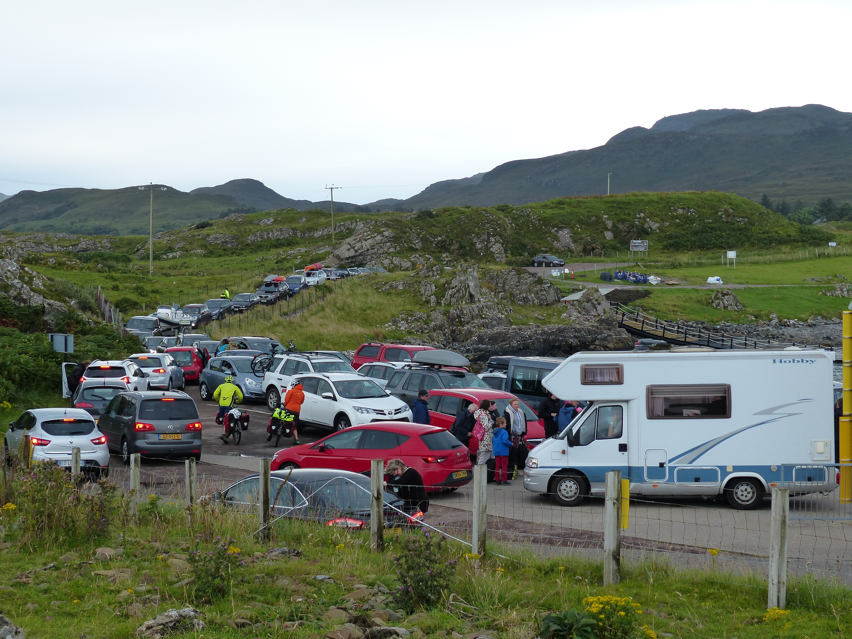 Cars and camper vans queue up for the ferry at Kilchoan on Saturday evening