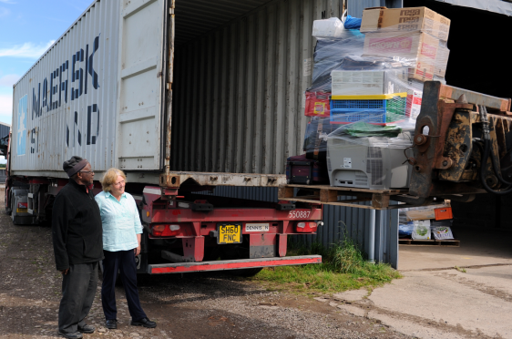 Moira and Lansana Bangura at Sherifston Farm, Elgin, loading the container truck, helped by willing volunteers, with goods for onward shipping to Sierra Leone. Picture by Gordon Lennox.