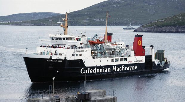 The CalMac ferry MV Hebridean Isles arriving at Castlebay on the Island of Barra.