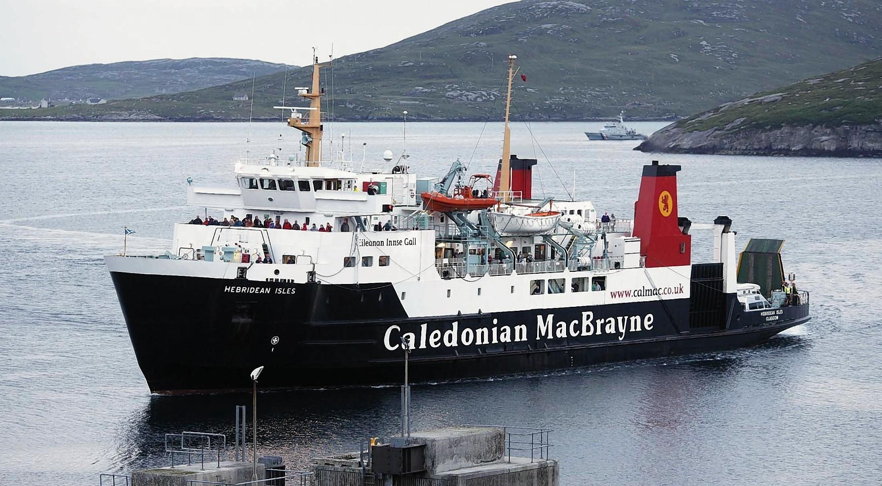 The CalMac ferry MV Hebridean Isles arriving at Castlebay on the Island of Barra.