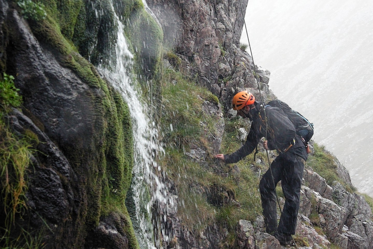 Dave Buckett carries out an examination on the North Face of Ben Nevis