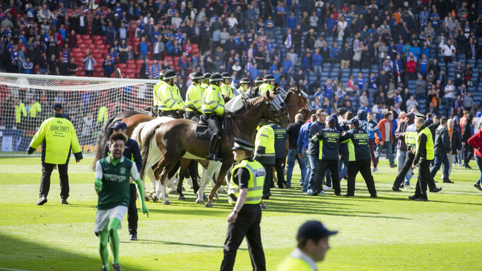 Mounted officers restored order following the pitch invasion at the end of the Scottish Cup final in May