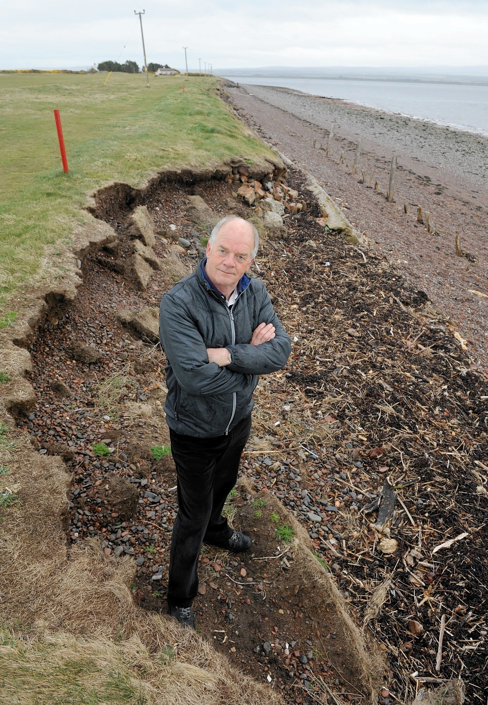 Former captain Phillip Thorn at the eroded area of Fortrose and Rosemarkie Golf Club