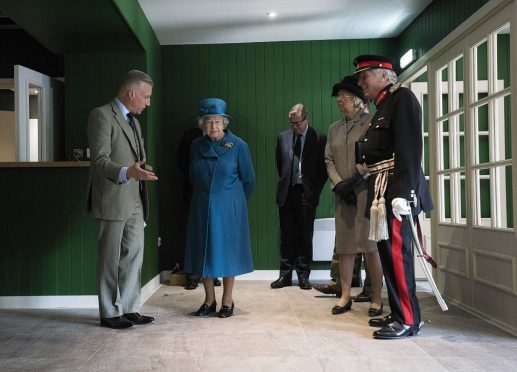 The Queen at Prince Charles's under-construction Highgrove outlet