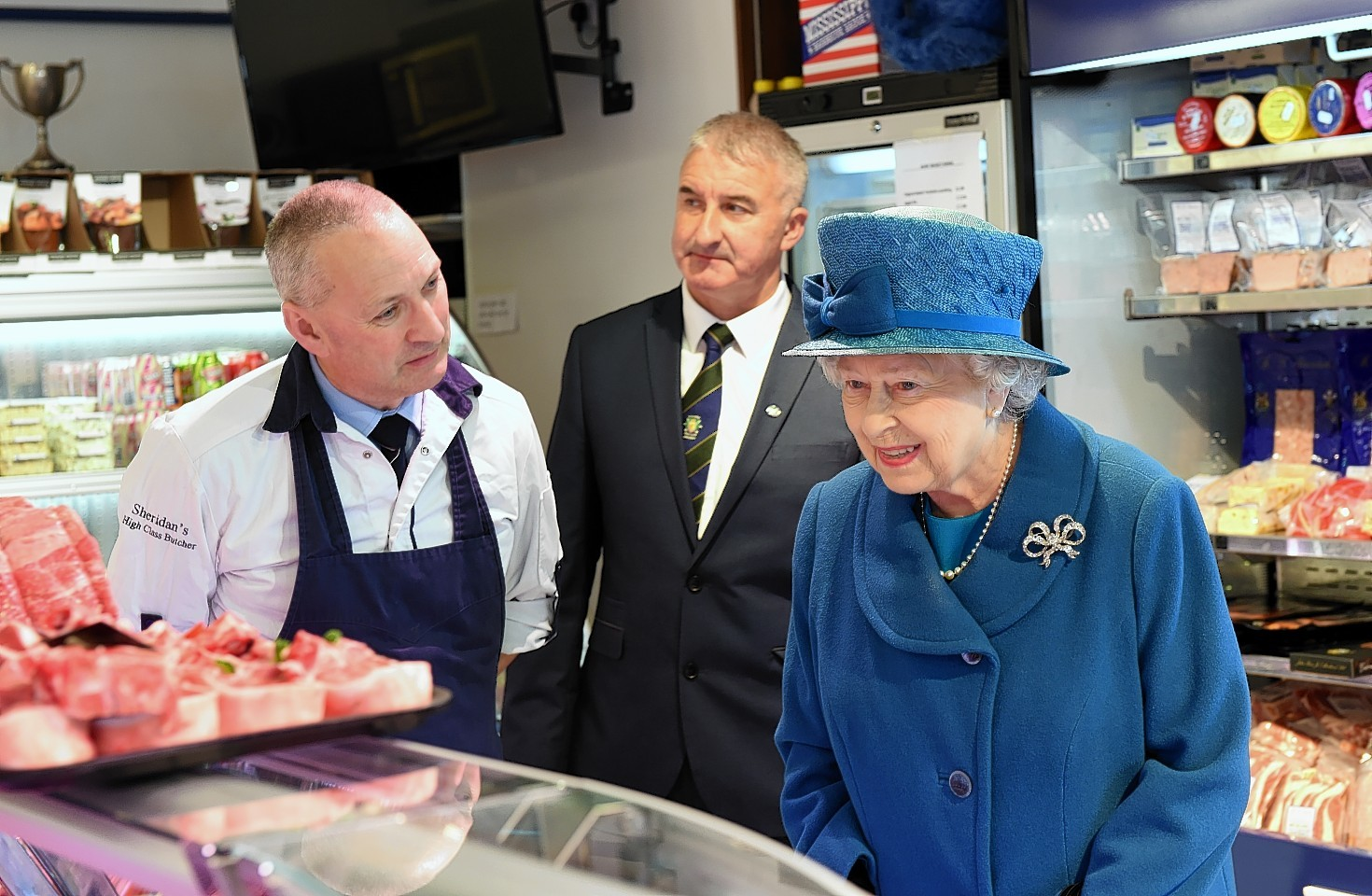 The Queen with Barry Florence, left, and John Sinclair, right - owners of HM Sheridans Butchers