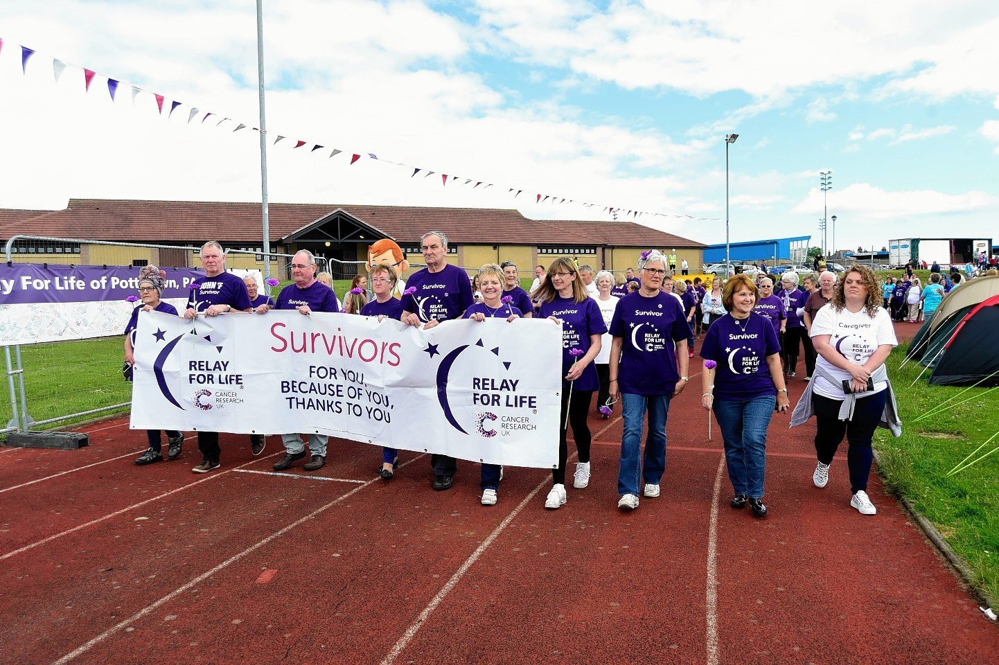 Survivors complete the lap of honour at Relay for Life