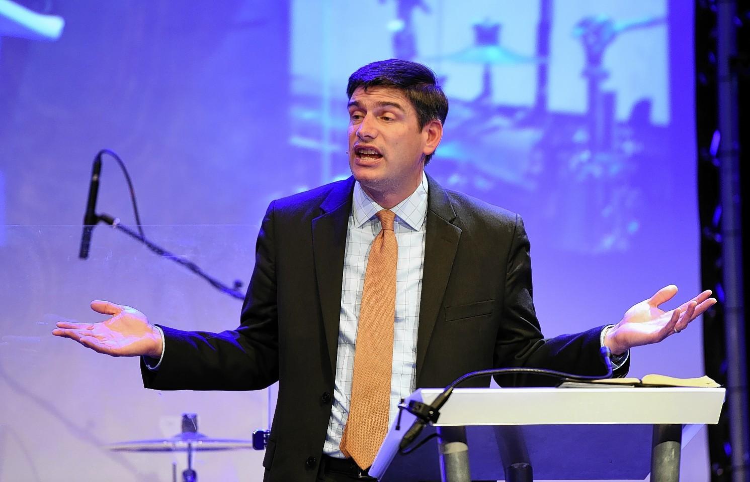 Evangelical preacher Will Graham speaking at Peterhead Academy