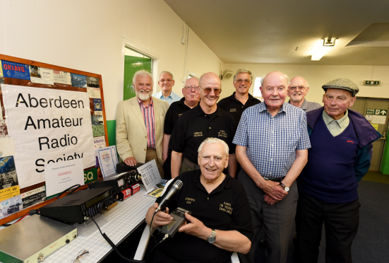 The Aberdeen Amateur radio society celebrates it's 70th anniversary. Picture at the scout hall, Oakhill Crescent Lane, Aberdeen is club chairman, Ian Fraser with other members.