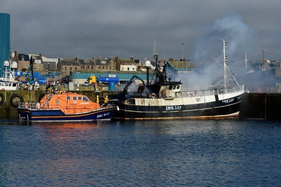 The Ardent II smoldering at Peterhead Harbour.
