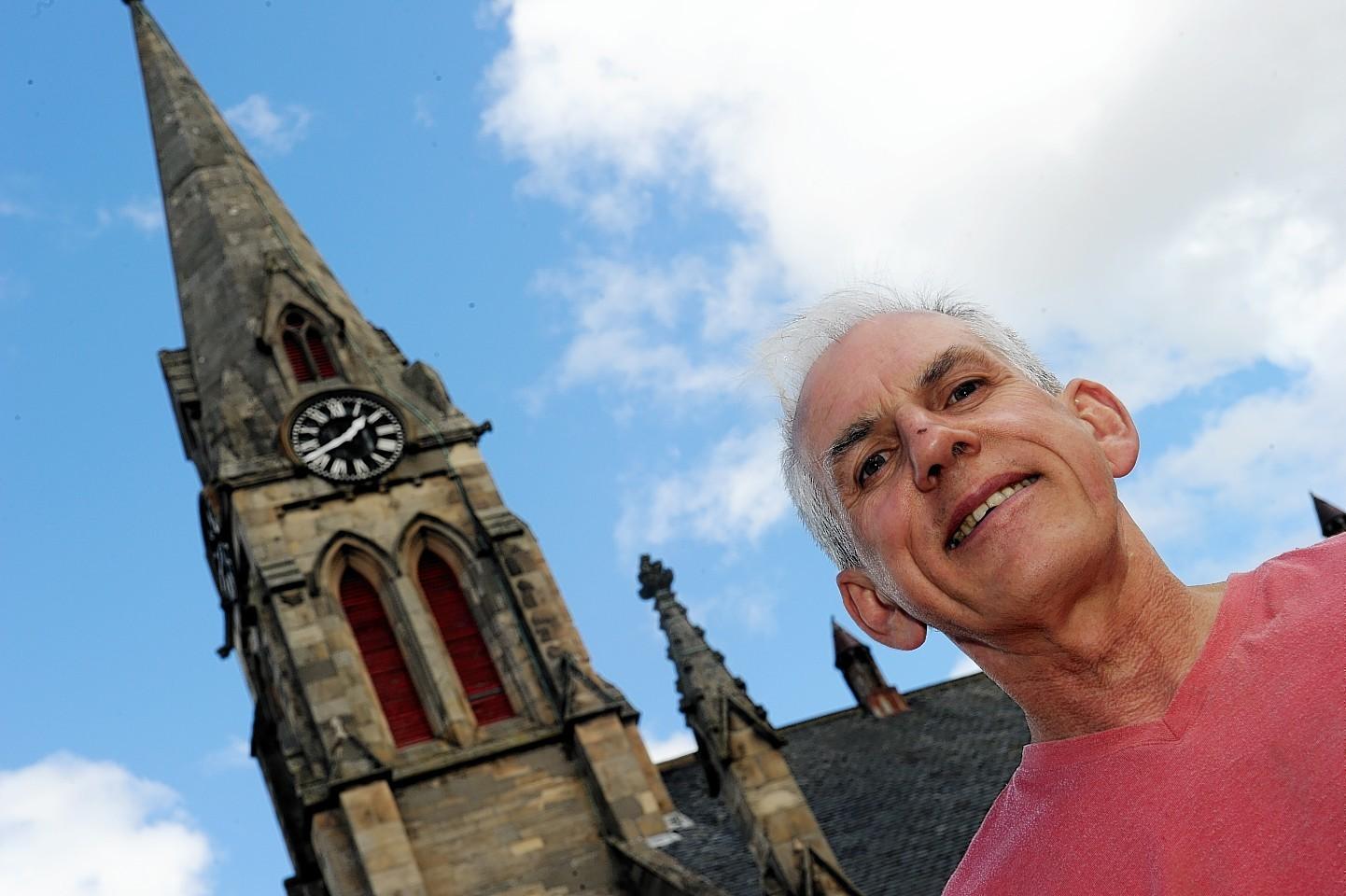Ali MacDonald has attempted to repair one of the tower clocks in Elgin