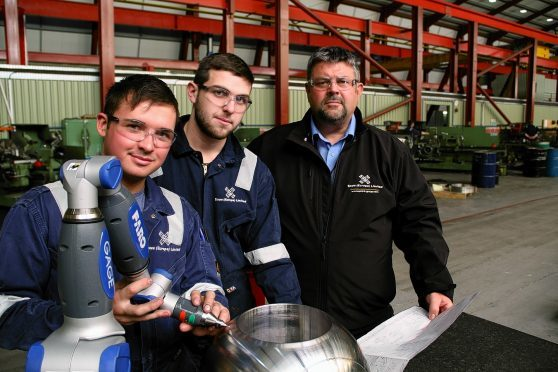 Score Group's Conrad Ritchie with apprentices Ross Smith and George Heatherwick