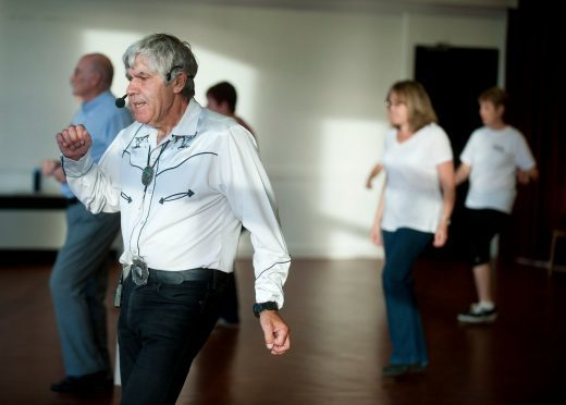 Ex-policeman and now line dancing teacher, Mike Baker, from Elgin, Moray, taking classes at the age of 75.