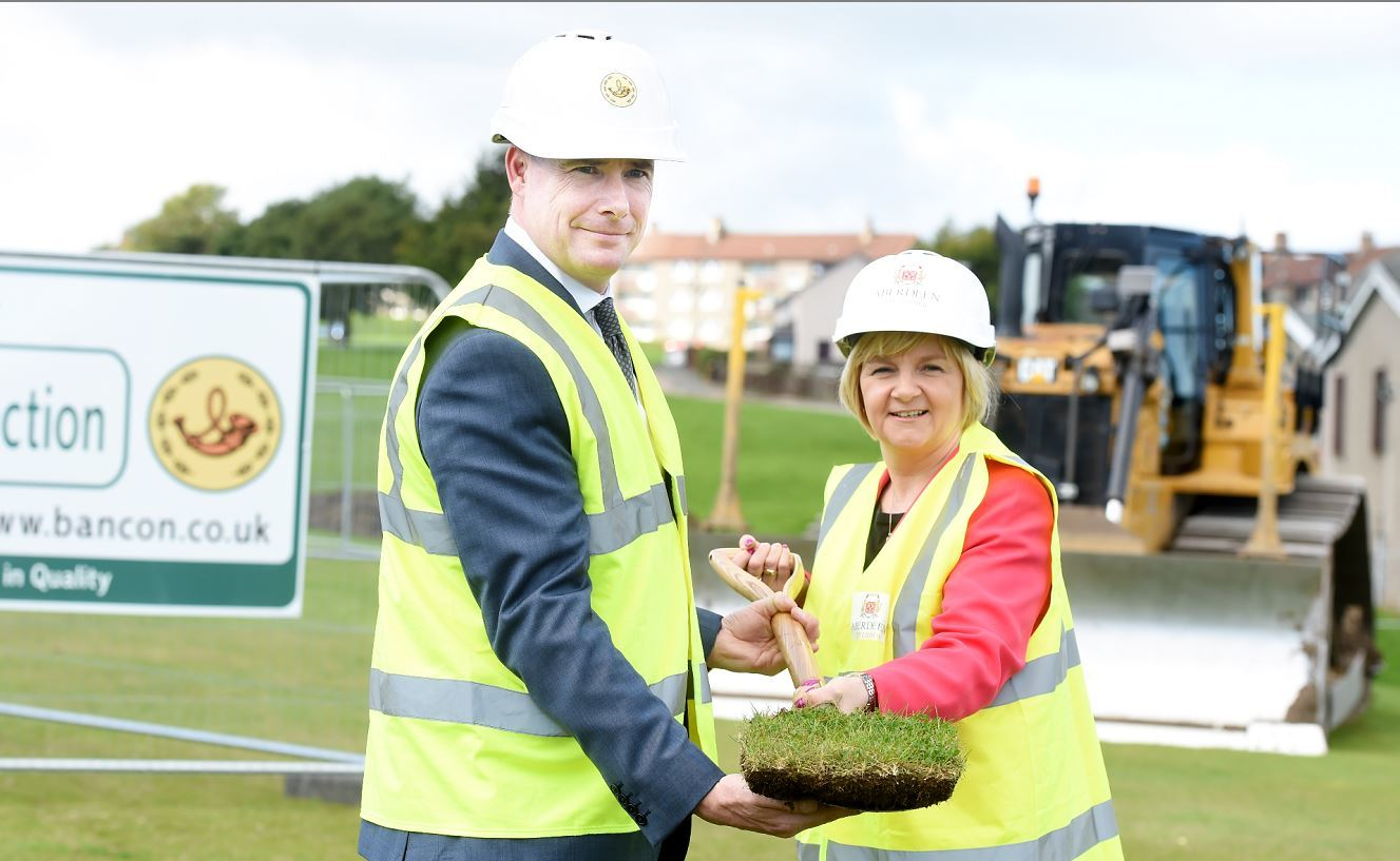 Sod cutting at manor walk, middlefield, Aberdeen, to build a housing development. In the picture are Gavin Currie, managing director, Bancon Constuction, left and Aberdeen City council leader, Jenny Laing.  Picture by Jim Irvine