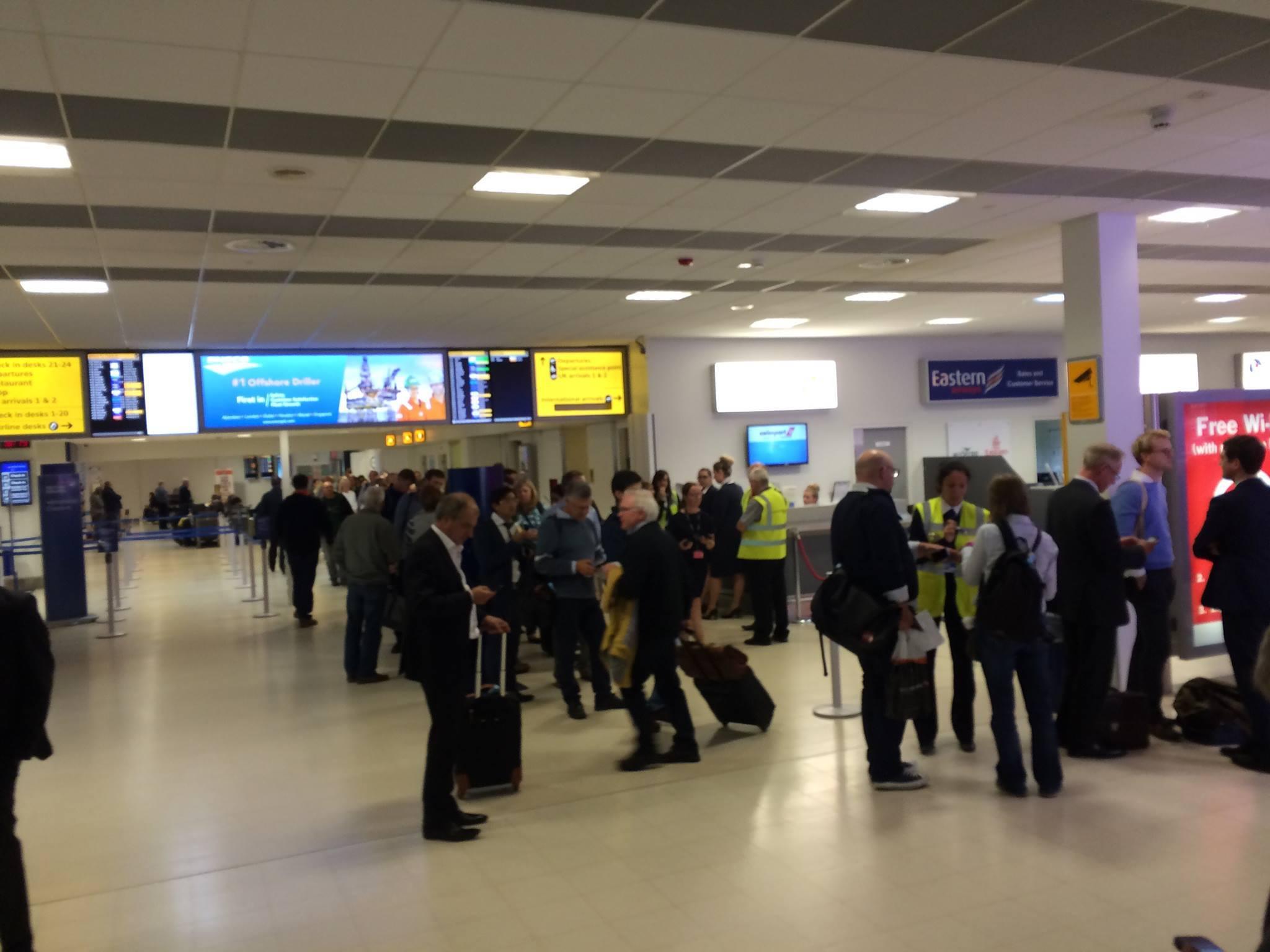 Passengers queue at Aberdeen Airport